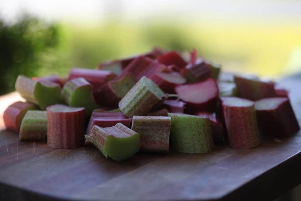 chopped fresh rhubarb on a cutting board