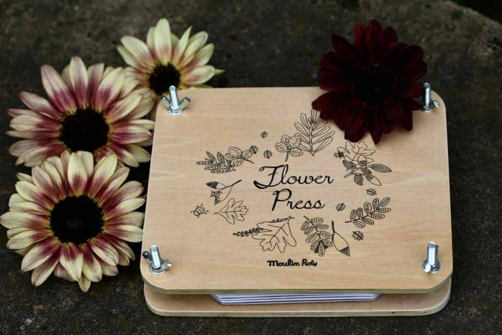 wooden flower press decorated with sunflowers of different colours